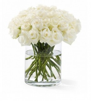 2 or 3 dozen of white roses with vase