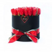 Red Tulips in Black Cylinder